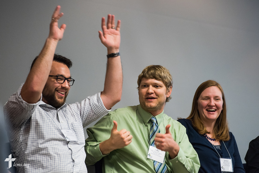 (L-R) The Rev. Matt Wood, pastor of Concordia Lutheran Church in Maplewood, Mo., the Rev. Luke Wolters, pastor at Grace Lutheran Church in Wellsville, Mo., and Jessica Wolters, gesture during a lighthearted moment  at the Post Seminary Applied Learning and Support (PALS) Facilitator Training Conference at the International Center of The Lutheran Church–Missouri Synod on Tuesday, August 4, 2015, in Kirkwood, Mo. LCMS Communications/Erik M. Lunsford