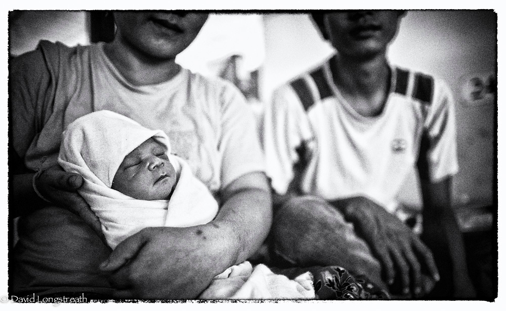 An ethnic Karen refugee mother and baby wait to see a doctor at the Mae Tao clinic in Mae Sot, Thailand. (Photo by David Longstreath)