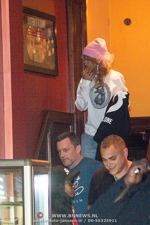 NLD/Amsterdam/20130623 - Rihanna verlaat de Amsterdamse coffeeshop Green House naar een verblijf van 3 uur  - American singer Rihanna leaving the coffeeshop after and staying of three hours smoking weed ,