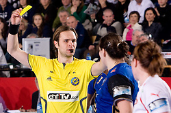 Refeere Siarhei Repkin of Belarus with yellow card during 3rd Main Round of Women Champions League handball match between RK Krim Mercator, Ljubljana and Larvik HK, Norway on February 19, 2010 in Arena Kodeljevo, Ljubljana, Slovenia. Larvik defeated Krim 34-30. (Photo by Vid Ponikvar / Sportida)