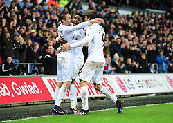 Gylfi Sigurdsson of Swansea City celebrates with Leroy Fer of Swansea City and Fernando Llorente of Swansea City - Mandatory by-line: Alex James/JMP - 31/01/2017 - FOOTBALL - Liberty Stadium - Swansea, England - Swansea City v Southampton - Premier League