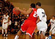 5 MARCH 2011 -- NORMANDY, Mo -- Chaminade College Prep basketball player Bradley Beal (23) slips past McCluer North High School's Tremayne Garrett (23) during the MSHSAA Class 5 boys basketball quarterfinals at Mark Twain Hall on the University of Missouri - St. Louis campus in Normandy, Mo. Saturday, March 5, 2011. The Stars upset the Red Devils 57-56 to advance to MSHSAA semifinals. Image © copyright 2011 Sid Hastings.