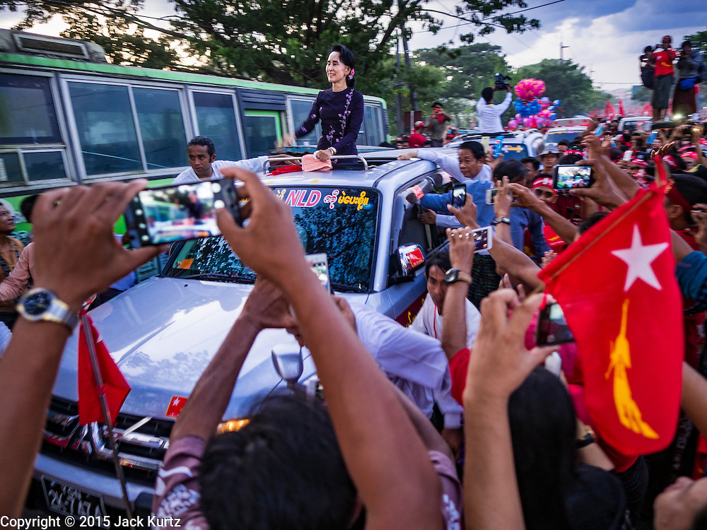 01 NOVEMBER 2015 - YANGON, MYANMAR:  AUNG SAN SUU KYI, the head of the NLD, drives through a crowd of supports as she leaves the NLD's last election rally of the 2015 election in the Yangon suburbs Sunday. Political parties are wrapping up their campaigns in Myanmar (Burma). National elections are scheduled for Sunday Nov. 8. The two principal parties are the National League for Democracy (NLD), the party of democracy icon and Nobel Peace Prize winner Aung San Suu Kyi, and the ruling Union Solidarity and Development Party (USDP), led by incumbent President Thein Sein. There are more than 30 parties campaigning for national and local offices.   PHOTO BY JACK KURTZ