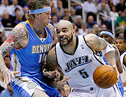 Utah Jazz forward Carlos Boozer (5) attempts to get past Denver Nuggets center Chris Anderson (11) during the second half of Game 6 of the NBA Western Conference first-round playoff series in Salt Lake City, Friday, April 30, 2010. Boozer scored 22 points in the Jazz 112-104 win.  (AP Photo/Colin E Braley)