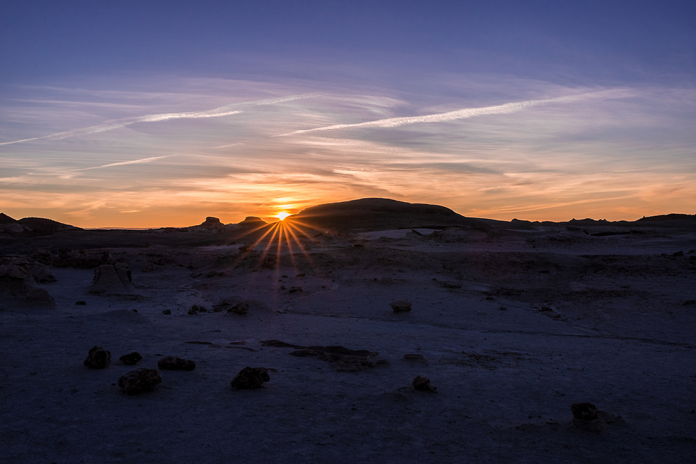 A sunset shot of a rock field in the Bisti Badlands in New Mexico.<br /> <br /> Camera <br /> NIKON D610<br /> Lens <br /> TAMRON SP 35mm F1.8 Di VC USD F012N<br /> Focal Length <br /> 35<br /> Shutter Speed <br /> 1/3000<br /> Aperture <br /> 13<br /> ISO <br /> 400