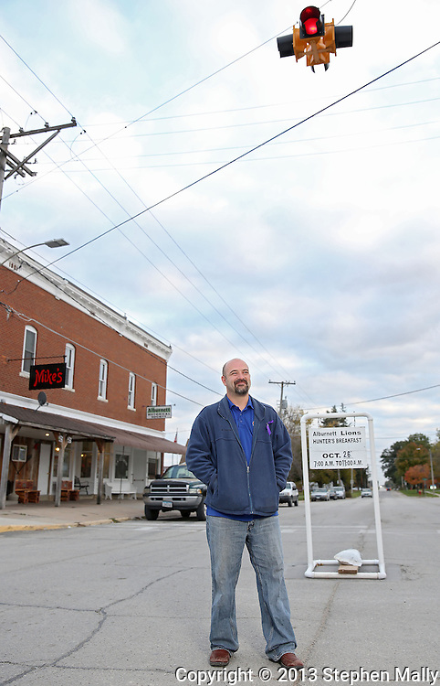 Jonathan Lawrence, current Alburnett city council member and candidate for mayor, on Main Street in Alburnett on Thursday, October 24, 2013.