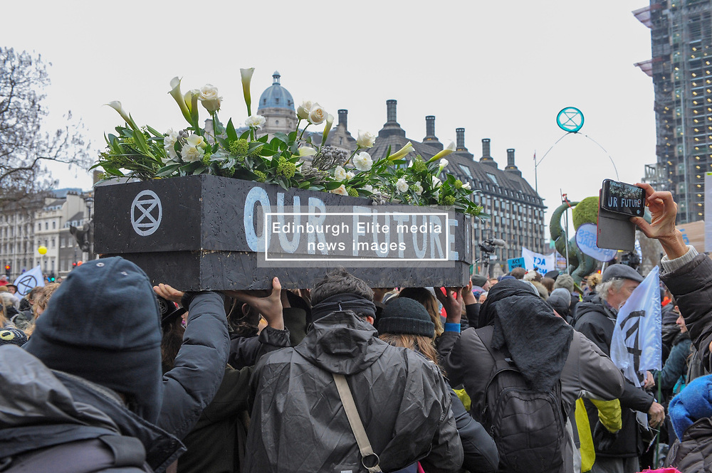 Extinction Rebellion campaigners came together in London for Rebellion Day 2. The protesters gathered on Parliament Square and blocked all roads leading up to the area. They carried a coffin and held a ceremony to mourn the life we have lost. The pro-people and planet group are calling on the Government to reduce carbon emissions to net zero by 2025 and to reduce consumption levels. London, 24 November 2018.