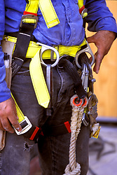 Stock photo of the safety harness and gear on workman