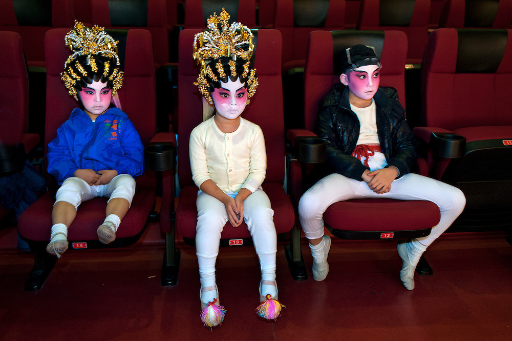 from the left: Wong Yuet (5), Yan-Ting (4), Siu-Kit (8) from Cha Duk Chang are waiting for further instructions during a very last rehearsal of the Opera they're about to perform. <br />