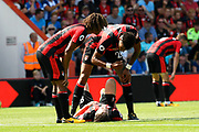 Harry Arter (8) of AFC Bournemouth lies on the pitch injured with Nathan Ake (5) of AFC Bournemouth and Tyrone Mings (26) of AFC Bournemouth bending over him during the Premier League match between Bournemouth and Manchester City at the Vitality Stadium, Bournemouth, England on 26 August 2017. Photo by Graham Hunt.
