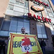 Sean Clerkin of the Scottish Resistance outside Tunnocks Factory in Uddingston to demonstrate their opposition to the removal of the lion rampant from the famous brand teacakes which are manufactured in the factory behind them. Picture Robert Perry 14th Jan 2016<br /> <br /> Must credit photo to Robert Perry<br /> FEE PAYABLE FOR REPRO USE<br /> FEE PAYABLE FOR ALL INTERNET USE<br /> www.robertperry.co.uk<br /> NB -This image is not to be distributed without the prior consent of the copyright holder.<br /> in using this image you agree to abide by terms and conditions as stated in this caption.<br /> All monies payable to Robert Perry<br /> <br /> (PLEASE DO NOT REMOVE THIS CAPTION)<br /> This image is intended for Editorial use (e.g. news). Any commercial or promotional use requires additional clearance. <br /> Copyright 2014 All rights protected.<br /> first use only<br /> contact details<br /> Robert Perry     <br /> 07702 631 477<br /> robertperryphotos@gmail.com<br /> no internet usage without prior consent.         <br /> Robert Perry reserves the right to pursue unauthorised use of this image . If you violate my intellectual property you may be liable for  damages, loss of income, and profits you derive from the use of this image.