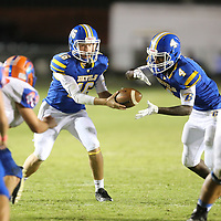 Booneville quarterback John Daniel Deaton hands the ball off to running back Dallas Gamble in the second quarter.