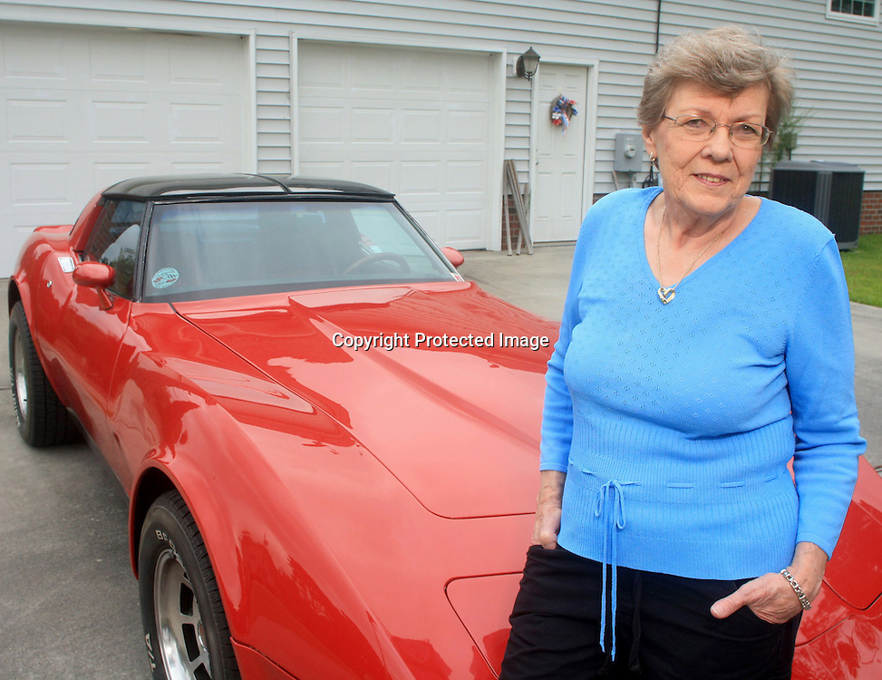 """Hedwig 'Sue' Bischoff poses for a portrait in front of her 1979 Corvette at her home in New Bern, N.C. on Monday August 19, 2013. Bischoff refers to the car as her """"toy"""" and is an active member of the local Twin Rivers Corvette Club. Bischoff had a posterior retroperitoneoscopic adrenalectomy, a new minimally invasive adrenal gland surgery performed at Duke University Hospital and has experienced a quicker-than-normal recuperation.  (Photo By: Jason A. Frizzelle)"""