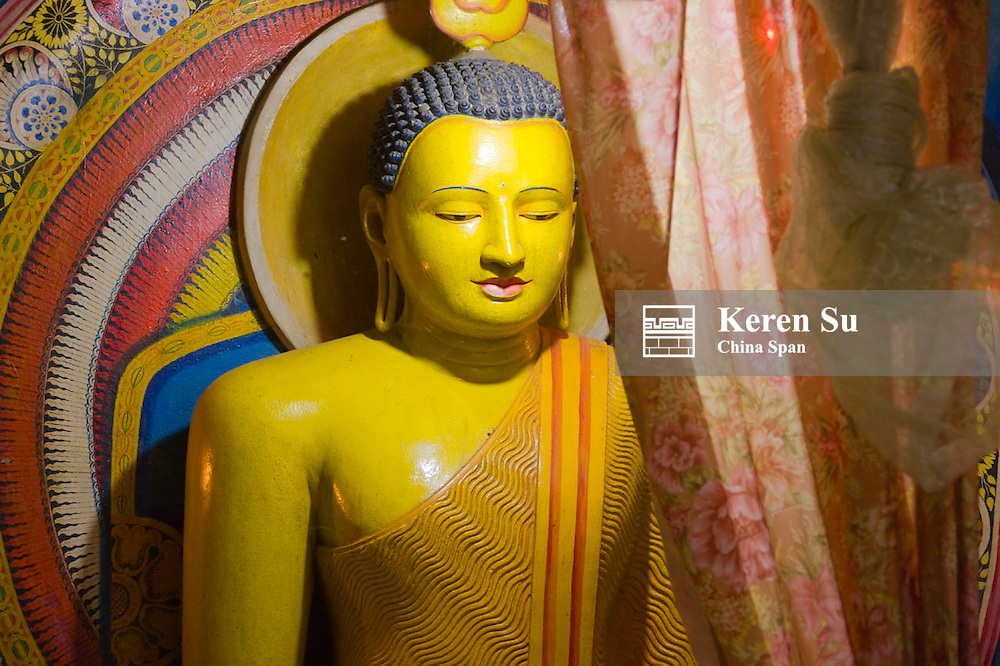 Buddhist statue in Temple of Tooth, Kandy, Sri Lanka