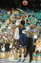 Virginia center Aisha Mohammed (33) leaps over Georgia Tech forward Daphne Mitchell (45) for the opening tip.  The #4 seed/#25 ranked Virginia Cavaliers women's basketball team defated the #5 seed Georgia Tech Yellow Jackets 52-43 in the quarterfinals of the 2008 ACC Women's Basketball Tournament at the Greensboro Coliseum in Greensboro, NC on March 7, 2008.