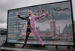 "© Licensed to London News Pictures. 22/06/2016. London, UK. Ryanair's CEO, Michael O'Leary, leaps from an ad van dressed in a Union and EU flag suit as he calls for a big ""Remain"" vote in the EU Referendum. The last day of campaigning for the EU referendum is taking place today. Photo credit: Peter Macdiarmid/LNP"