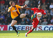 Moses Odubajo of Leyton Orient (right) and Adam Reach of Bradford City (left)  challenge for the ball during the Sky Bet League 1 match at the Matchroom Stadium, London<br /> Picture by David Horn/Focus Images Ltd +44 7545 970036<br /> 29/03/2014