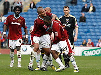 Photo: Paul Greenwood/Richard Lane Photography. <br />Burnley v Cardiff City. Coca-Cola Championship. 26/04/2008. <br />Burnley's Andrew Cole has to be restrained after a challenge by Cardiff's Darren Purse