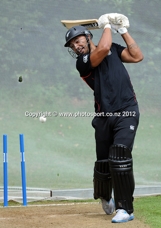 Krisnan Inu swings and misses as the Vodafone Warriors joined the New Zealand Black Caps for a training session at Colin Maiden Oval, Auckland on Tuesday 21 February 2012. Photo: Andrew Cornaga/Photosport.co.nz