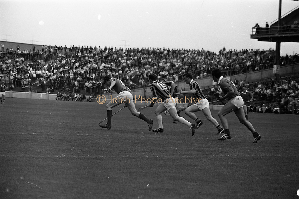 17/08/1969<br /> 08/17/1969<br /> 17 August 1969<br /> All-Ireland Senior Semi-Final: Kilkenny v London at Croke Park, Dublin.<br /> Kilkenny forwards (in center) and london players follow the ball near the London goalmouth. Players are: London's P. O'Fathaigh (left) and Kilkenny's S.O. Maolaoidh (13).