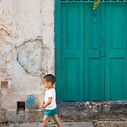 Young boy playing in street in Old Havana