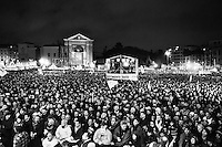Sympathisers and supporters of the Five Stars Movement listen to former comedian Beppe Grillo, blogger and leader of the movement, during his last campaign rally for the general election in San Giovanni square (the square where left-wing party and unions<br /> historically rallied) where he attracted more than 500,000 people according to various estimates, making it one of the biggest political rallies ever seen in Italy, in Rome, Italy, on February 22nd, 2013.<br /> <br /> In the general elections of February 24-25, the Five Stars Movement won 25.6% of the vote for the Chamber of Deputies, more than any other single party though both the Italy Common Good centre-left coalition, centred on the Democratic Party, and the centre-right alliance, centred on The People of Freedom, obtained more votes as coalitions.
