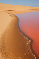 A colorful salt lagoon south of Walvis Bay, Namibia