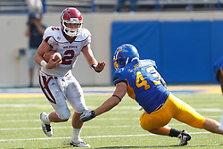 September 24, 2011; San Jose, CA, USA;  New Mexico State Aggies quarterback Matt Christian (2) is tackled by San Jose State Spartans defensive end Travis Johnson (43) during the fourth quarter at Spartan Stadium. San Jose State defeated New Mexico State 34-24.