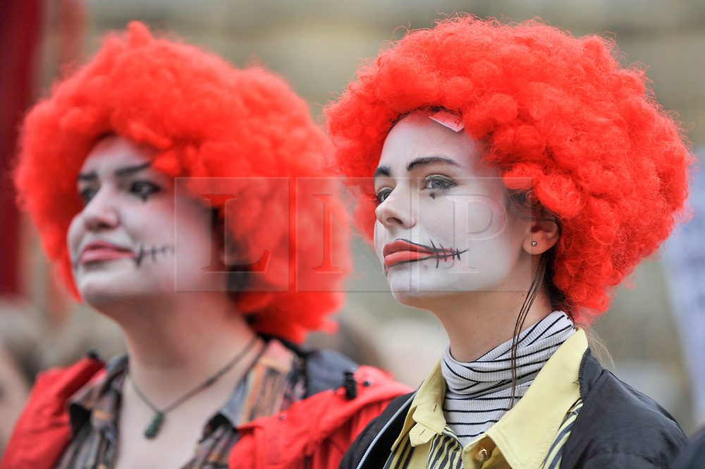 © Licensed to London News Pictures. 04/09/2017. London, UK. Women dressed as Ronald McDonald join McDonald's staff and members of the Bakers Food and Allied Workers Union (BFAWU) at a rally outside the Houses of Parliament in solidarity with McDonald's staff in Cambridge and Crayford who have gone on strike demanding an end to zero hours contracts and a minimum wage of GBP10 per hour.   Photo credit : Stephen Chung/LNP