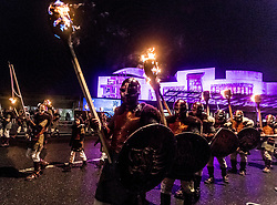 Edinburgh's Hogmanay celebrations start with the traditional torchlit procession. This year the route finishes outside the Scottish Parliament in  Holyrood where a word chosen by the young people of Scotland that makes them proud to live in the country is revealed by the thousands of torch bearers.<br /> <br /> Pictured: Jarls Men from Shetland who lead the parade in front of the Scottish Parliament.