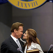 Arnold Schwarzenegger kisses his wife Maria Shriver after he takes the oath of office as California's 38th governor in Sacramento, California.