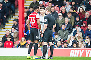 John Brooks (Referee) talking with Tom Lawrence (Derby County) & Julian Jeanvier (Brentford) after their clash during the EFL Sky Bet Championship match between Brentford and Derby County at Griffin Park, London, England on 6 April 2019.