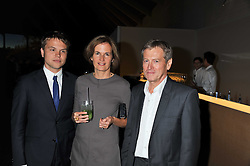 Left to right, CAIUS PAWSON and JOHN & CATHERINE PAWSON at a dinner hosted by Calvin Klein Collection to celebrate the future Home of The Design Museum at The Commonwealth Institute, Kensington, London on 13th October 2011.