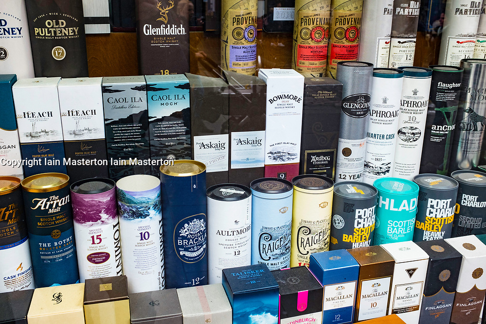 Window display of many varieties Scotch Whisky in tourist gift shop on Royal Mile in Edinburgh, Scotland, United Kingdom