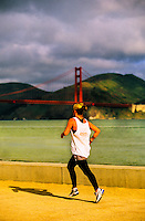 Women jogging near Marina, Golden Gate Bridge in background, San Francisco, California USA