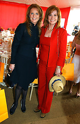 Left to right, SARAH, DUCHESS OF YORK and actress STEFANIE POWERS at the Veuve Clicquot sponsored Gold Cup or the British Open Polo Championship won by The  Azzura polo team who beat The Dubai polo team 17-9 at Cowdray Park, West Sussex on 18th July 2004.