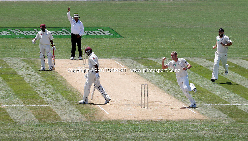Umpire Ameish Saheba raises the finger as Ian O'Brien celebrates one of six wickets in the innings during play on day 2 of the second cricket test at McLean Park in Napier. National Bank Test Series, New Zealand v West Indies, Saturday 20 December 2008. Photo: Andrew Cornaga/PHOTOSPORT
