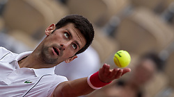 May 30, 2018 - Paris, Ile-de-France, France - Novak Djokovic of Serbia serves against Jaume Munar of Spain during the second round at Roland Garros Grand Slam Tournament - Day 4 on May 30, 2018 in Paris, France. (Credit Image: © Robert Szaniszlo/NurPhoto via ZUMA Press)