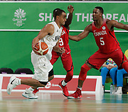 14th April 2018, Gold Coast Convention and Exhibition Centre, Gold Coast, Australia; Commonwealth Games day 10, Basketball, Mens semi final, New Zealand versus Canada; Mika Vukona of New Zealand drives to the basket as Munis Tutu and Jean Charles-Pierre defend