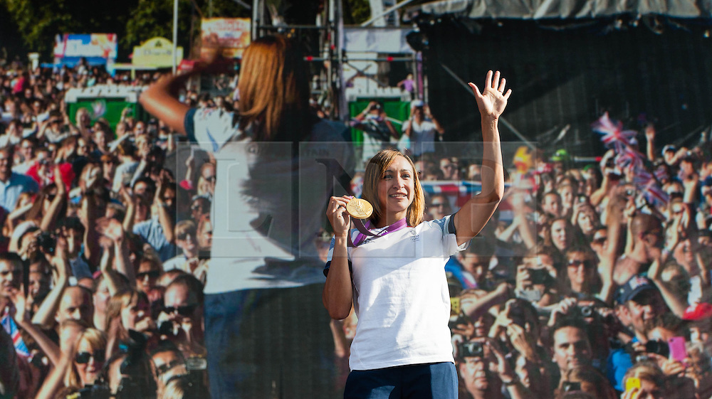 © Licensed to London News Pictures. 05/08/2012. London, UK.     Team GB gold medal winning heptathlete Jessica Ennis on-stage at BT London Live, Hyde Park. Jessica won the gold medal yesterday. Jessica was interviewed by Absolute Radio presenter Johnny Vaughan.  A video screen showing Hyde Park packed with people to see Jessica is the backdrop.  Photo credit : Richard Isaac/LNP