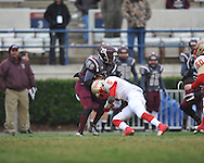 Lafayette High's Zeke Liggins (5) vs. Forrest County AHS' Darius Leggett (20) in the MHSAA Class 4A championship game at Mississippi Veterans Memorial Stadium in Jackson, Miss. on Saturday, December 7, 2013. Forrest County AHS won 21-6.