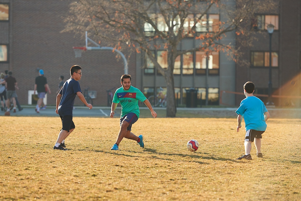 Activity; Playing; Relaxing; Socializing; Location; Outside; People; Student Students; UWL UW-L UW-La Crosse University of Wisconsin-La Crosse; Spring; March; Time/Weather; evening; Type of Photography; Candid; Diversity; Soccer; Campus Life