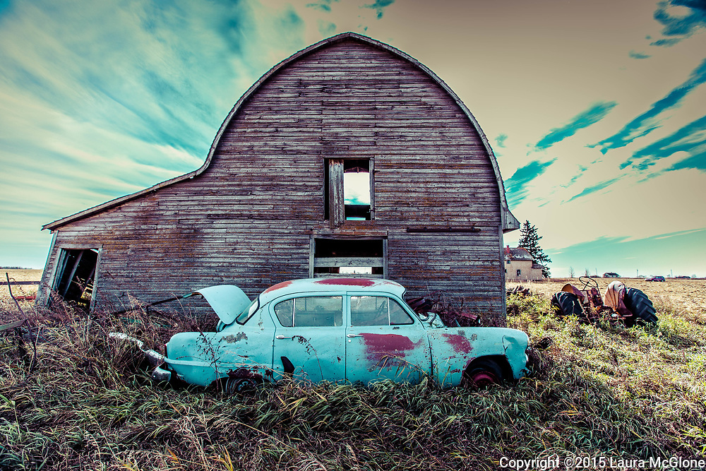 Alberta Canada, rural scene with barn & abandoned blue antique vehicle