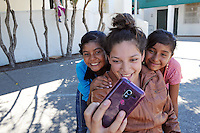 From left, Loma Vista Elementary School students Monzerrat Mata, 11, Frida Aguirre Ceja, 10 and Monzerrat's sister Marisol, 10, take a selfie after school on Monday behind the Hebbron Family Center. Monzerrat's 12th birthday is tomorrow, September 16th, the anniversary of Mexico's independence from Spain.
