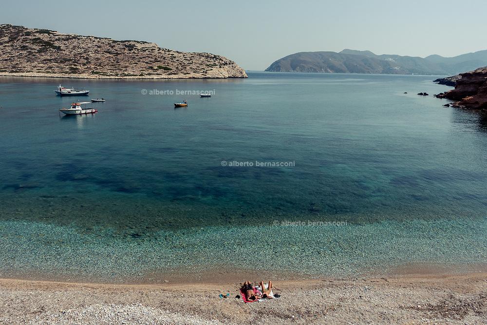 Greece, Amorgos island, relaxing on the beach