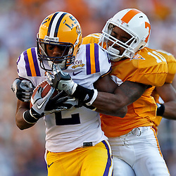 Oct 2, 2010; Baton Rouge, LA, USA; LSU Tigers wide receiver Rueben Randle (2) catches a pass over Tennessee Volunteers cornerback Marsalis Teague (10) during the second half at Tiger Stadium. LSU defeated Tennessee 16-14.  Mandatory Credit: Derick E. Hingle