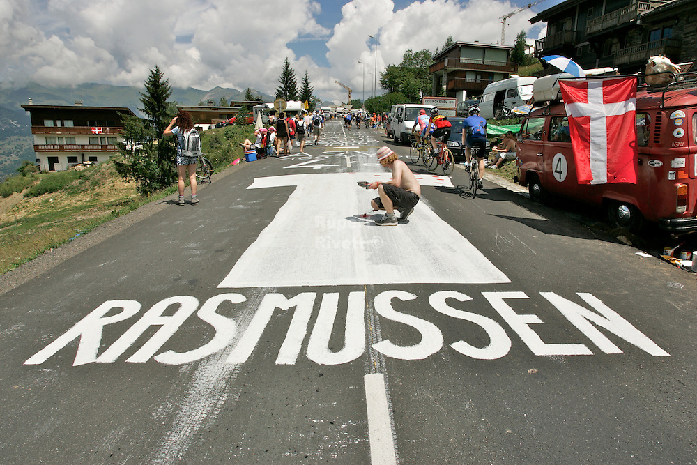Rasmussen cycling fans get busy with their road paint skills at the Tour de France 2005