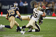 ST. LOUIS - SEPTEMBER 23:  Tight end Ernie Conwell #85 of the New Orleans Saints bobbles a pass broken up by safety Jerome Carter #42 and picked off for a game clinching touchdown by safety Mike Furrey #25 of the St. Louis Rams at the Edward Jones Dome on September 23, 2005 in St. Louis, Missouri. The Rams defeated the Saints 28-17. ©Paul Anthony Spinelli *** Local Caption *** Ernie Conwell;Jerome Carter;Mike Furrey