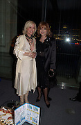 Sally Greene and Joan Collins, Fundraising party with airline theme in aid of the Old Vic and to celebrate the appointment of Kevin Spacey as artistic director.  <br />Old Billinsgate Market.  5 February 2003. © Copyright Photograph by Dafydd Jones 66 Stockwell Park Rd. London SW9 0DA Tel 020 7733 0108 www.dafjones.com