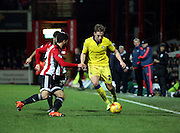Leeds United defender Charlie Taylor running down the wing during the Sky Bet Championship match between Brentford and Leeds United at Griffin Park, London, England on 26 January 2016. Photo by Matthew Redman.
